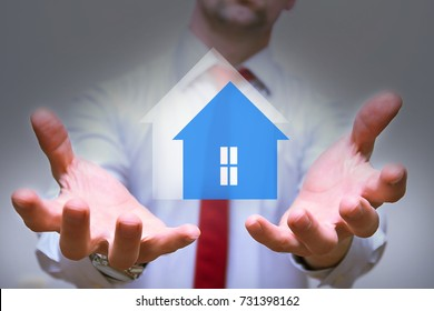 background real estate agency hands of a realtor with an illustration of a house / real estate agency