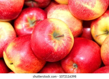 background of red apples for sale in the greengrocer's shop