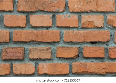 Background from the red brick laid with cement mortar close up