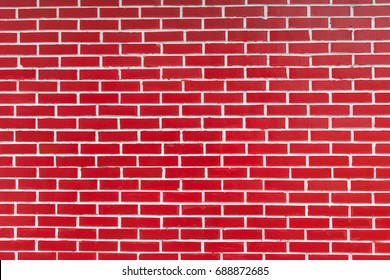 Background of red brick wall with peeling plaster texture