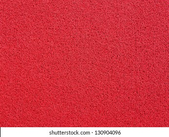Background of red carpet or foot scraper