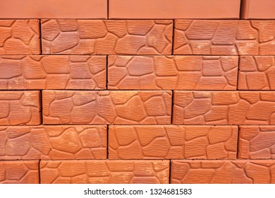 Background of red ceramic bricks with a pattern