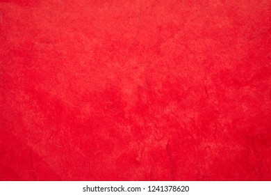 background of red, textured, handmade mulberry paper