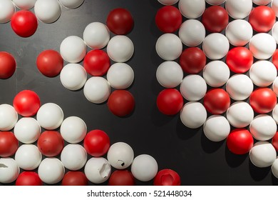Background of Red and White Sphere on Black Wall with Dramatic Lighting