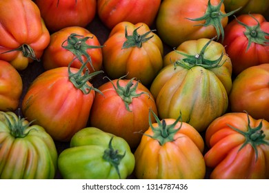Background of ripe non-GMO tomatoes on the market in Milan in Italy.
