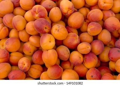 Background of ripe orange organic apricots