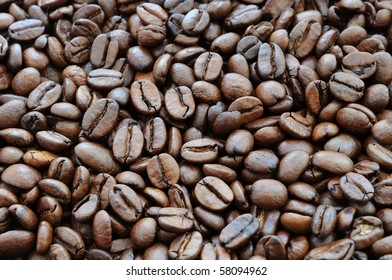 Background of roasted beans of black coffee