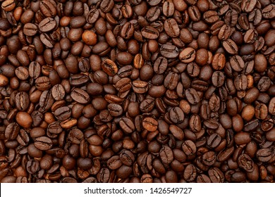 Background of roasted coffee beans. Top view, close-up.