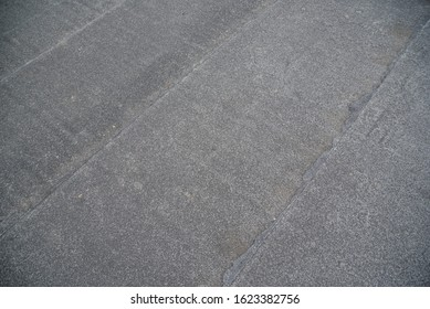 Background of roll roofing at construction site