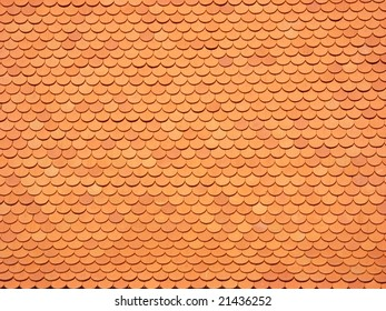 Background of a roof with brick-red tiles