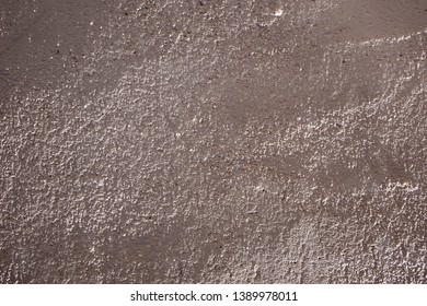 Background of rough uneven textured surface of concrete wall covered with plaster
