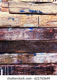 Background of rough wood; background of rough, stained wooden railway sleepers