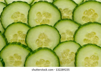 Background of rows of juicy cucumber slices