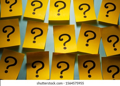 Background of rows of yellow question marks
