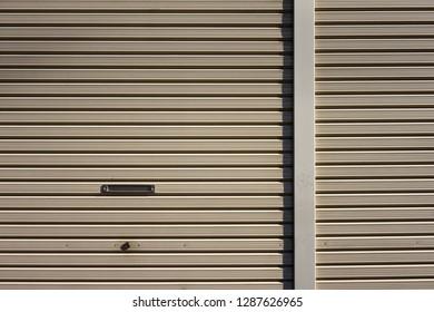 Background of the rust metal door. grunge metallic roller shutter door