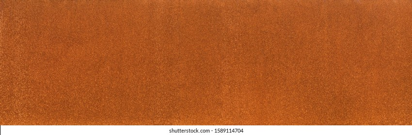 Background rust texture as a panorama homogeneous rust surface made of corten steel