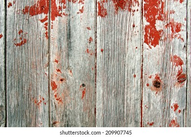 A background of rustic, aged barn-wood boards, with peeling red paint.