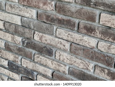 Background of rustic sandblasted bricks wall, sandblasted bricks textures.