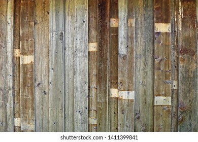 Background of a rustic weathered barn wood with nails. Nice textures