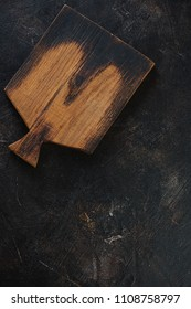 Background with a rustic wooden chopping board and lots of space, flatlay, vertical shot