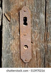 Background rusty lock on the wooden door