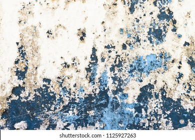 Background of rusty, white, blue colored metal surface.