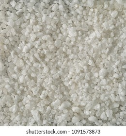 The background of the salt surface or texture is made from seawater. Salt is very popular in areas near the sea for use as a background. Top view,  Flat lay. space for text