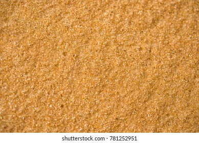Background. Sand close-up with large grains of sand