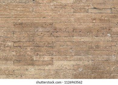 Background of sand color brick wall texture.