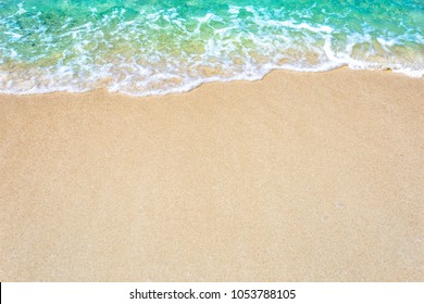 The background of sand with water splash into summer with space for text.