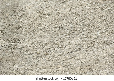 background of sandy limestone in sunlight with small and big stones