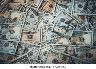background from scattered dollar banknotes as abstract seamless. toned image