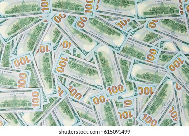 Background from scattered dollar banknotes as abstract seamless.