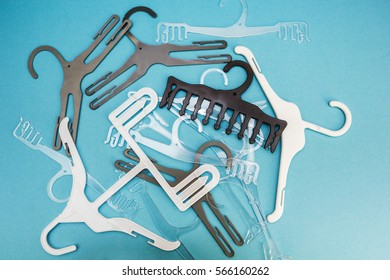 Background of scattered hangers for clothes on a blue