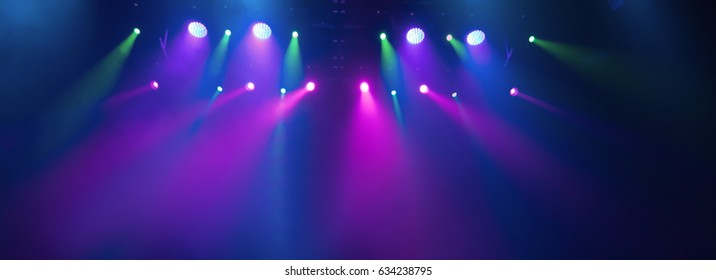 background scene, texture stage light with colored spotlights and smoke