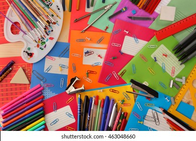 Background of school notebooks, pencils, pens, staplers, rulers and other school supplies.