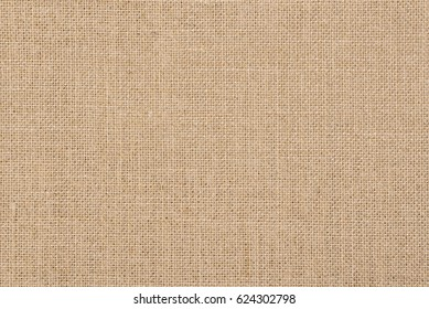 A background of a scratchy burlack material in an even light brown color. Backgrounds and textures. Natural fabrics. Organic materials.