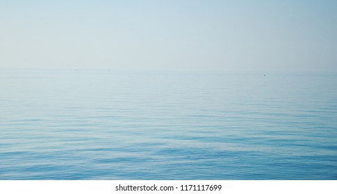 background of the sea in bibione, italy , pure calm blue ocean with room for text