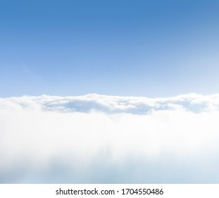 Background of sea of clouds against blue sky