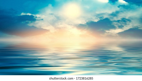 Background of a sea landscape. Blue sky with clouds over the sea. Sunlight, sunset