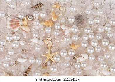 background of sea shells with pearls and rose quartz