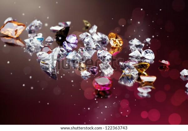 多くの異なる宝石のセットの背景