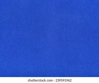 background from sheet of dark blue color velvet paper close up
