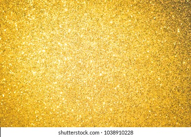 Background shine glitter gold texture. Abstract crystal beauty pattern brilliant.