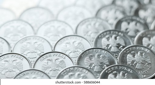 background of Shiny, metallic coins of one ruble orderly arranged on the plane.