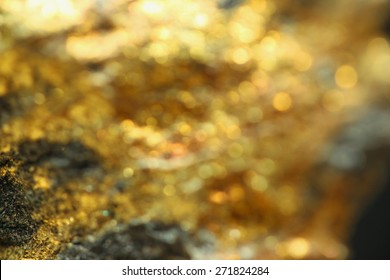 Background with shiny yellow gold and copper ore