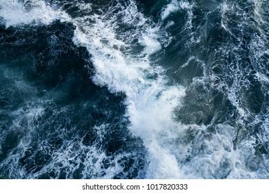 Background shot of aqua sea water surface. Background shot of aqua ocean water surface. Powerful ocean waves breaking natural background. powerful sea waves breaking natural background