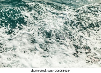 The background shot of aqua sea water surface