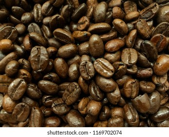 Background shot of roasted brown coffee beans