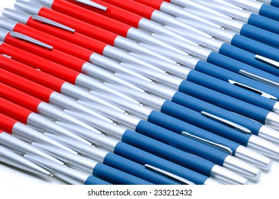 Background from silver-red and silver-blue metal pens.